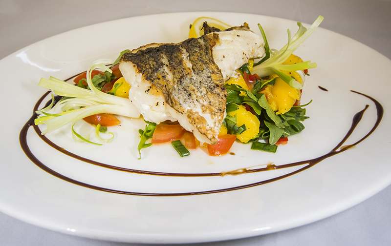 Fillet of sea bass with a mango and tomato relish